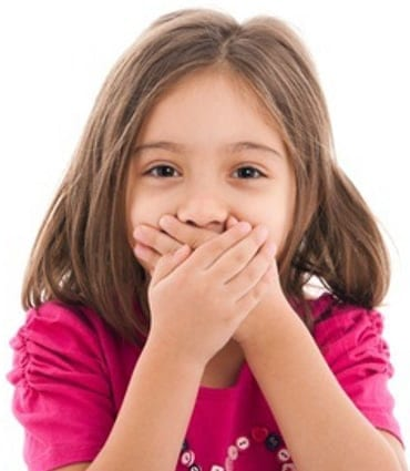 Young Kidz Dental_Young Girl Covering her Mouth